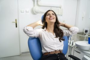 Woman smiling during her visit to the dentist